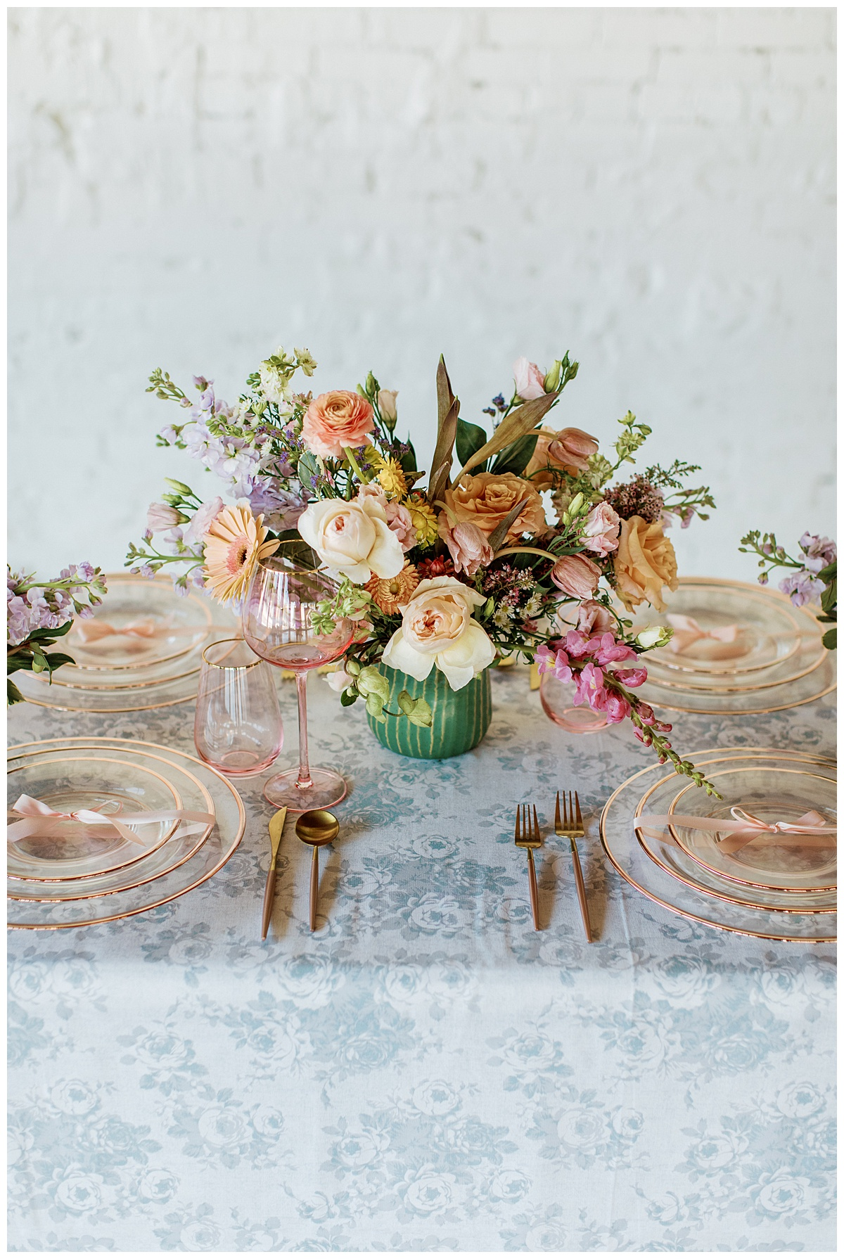 spring Easter tablescape with colorful flowers and pink dinnerware